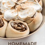 Pinterest image of s'mores rolls partially covered with marshmallow topping | All Images © Beyond the Butter™