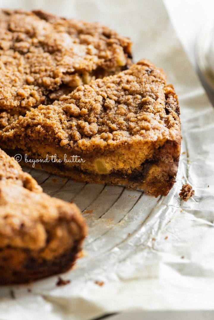 Side view of sliced cinnamon apple coffee cake | All Images © Beyond the Butter™