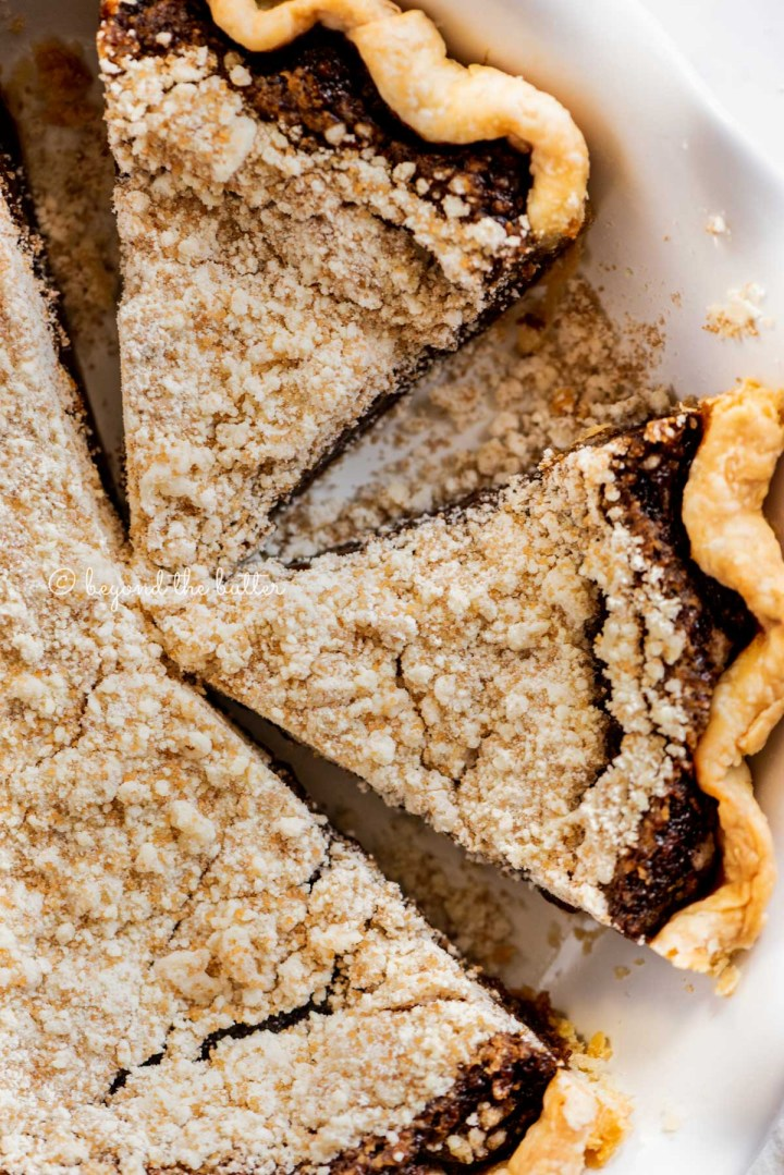Overhead close up image of pennsylvania dutch shoo fly pie with slices removed | All Images © Beyond the Butter™