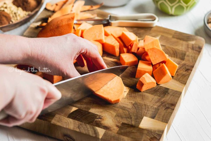 Cutting chunks of sweet potato for brown sugar sweet potato pie recipe from Beyond the Butter® | All Images © Beyond the Butter®