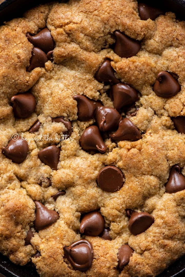 Closeup of brown butter chocolate chip skillet cookies | All Images © Beyond the Butter®