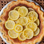 lemon sponge pie decorated with candied lemon sliced on seat of vintage wooden chair | All images © Beyond the Butter®