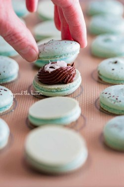 Sandwiching a robin's egg macaron shell together with another macaron shell | All images © Beyond the Butter®