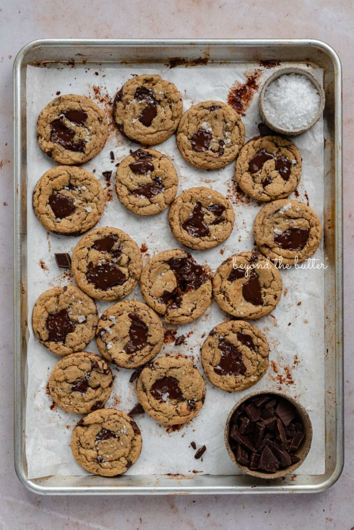 Small batch gluten-free peanut butter chocolate chunk cookies on a parchment paper lined baking sheet | © Beyond the Butter®