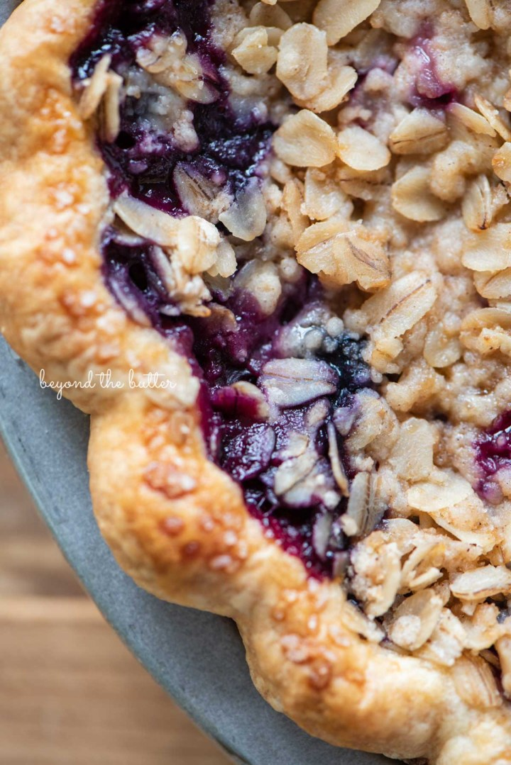 Upclose image of blueberry crumble pie crust edge   © Beyond the Butter®