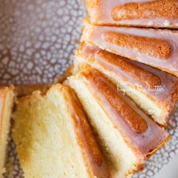 Sliced lemon cream cheese pound cake with a lemon glaze | © Beyond the Butter®