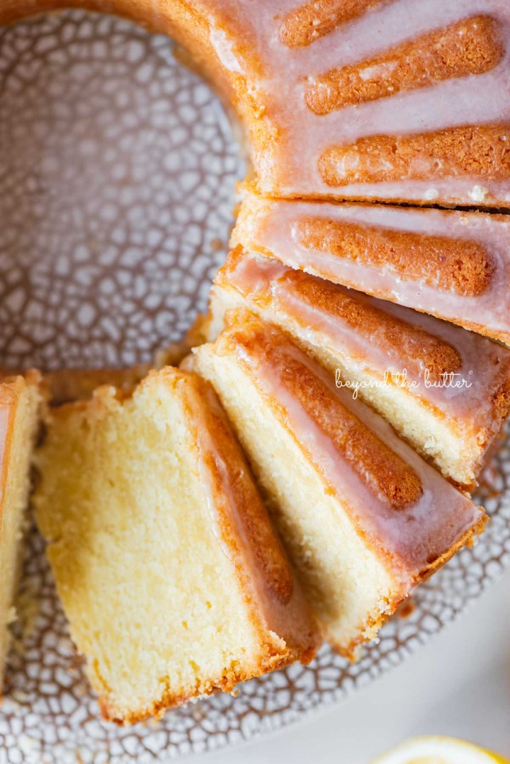 Soft and tender lemon cream cheese pound cake with a lemon glaze | © Beyond the Butter®