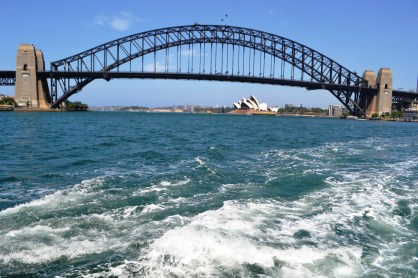 The Sydney Harbour Bridge and the Opera House viewed from a ferry looking East.