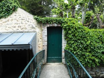 A smartly restored garden door and wash house canopy