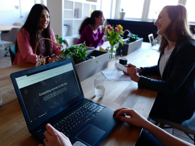 three-women-on-table-2041625