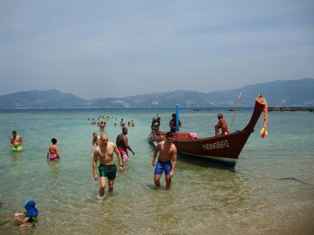 Paradise beach long tail boat
