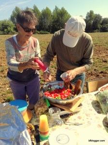 Finishing touches are made on a fresh green salad with tomatoes straight from the garden