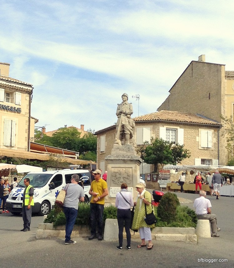 Village square in Gordes with WWII memorial