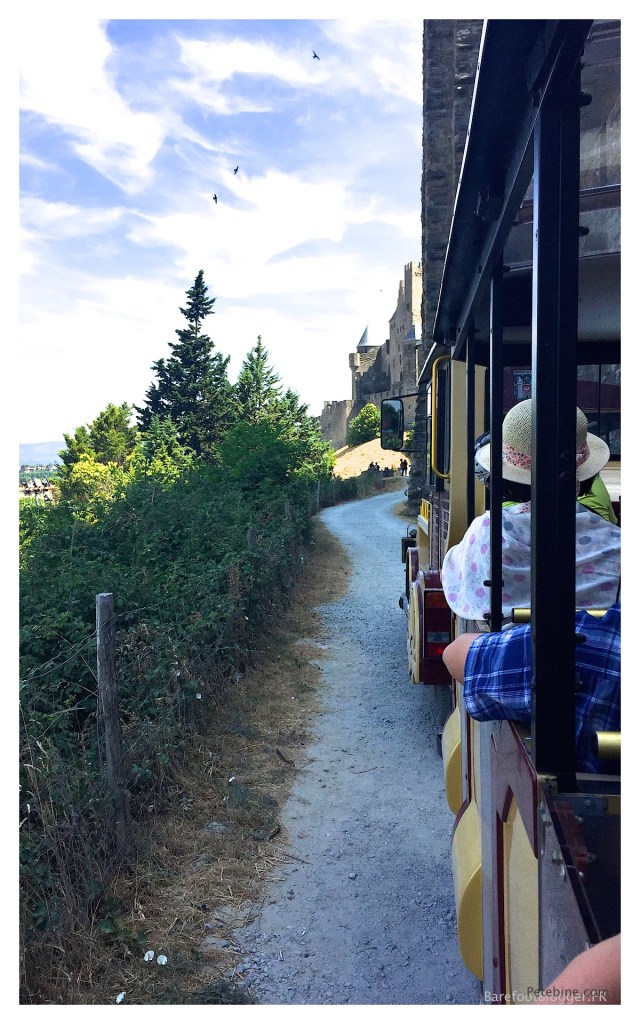 Train travels around the exterior of the city of Carcassonne