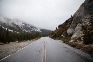 An open road surrounded with mountains