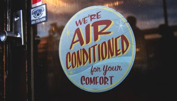 "Shop sign: ""We're air conditioned for your comfort"" - 7tips for buying the right air con unit for your business"