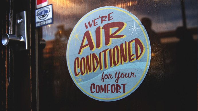 """Shop sign: """"We're air conditioned for your comfort"""" - 7tips for buying the right air con unit for your business"""