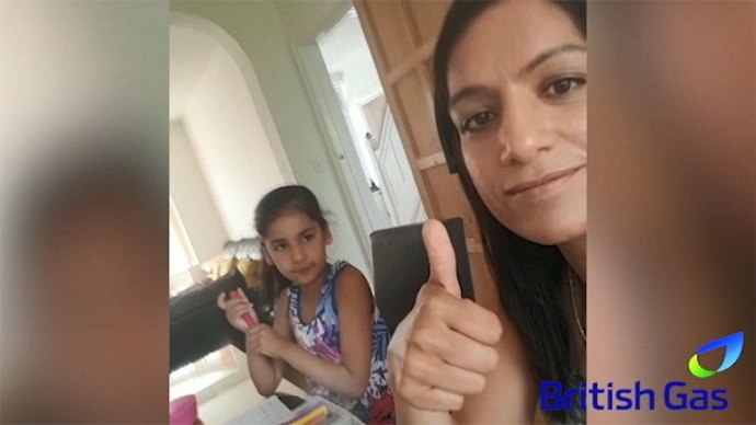 BG Woman employee with thumbs up with daughter in background - How we're adapting customer support after coronavirus