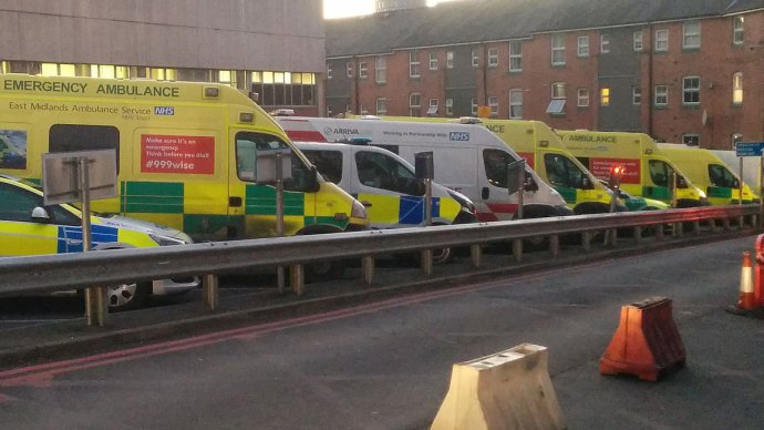 Ambulances parked up at a diagonal outside a hospital - 3 ways to manage business energy reducing cost & hassle - Victuallers / CC BY-SA (https://creativecommons.org/licenses/by-sa/3.0)