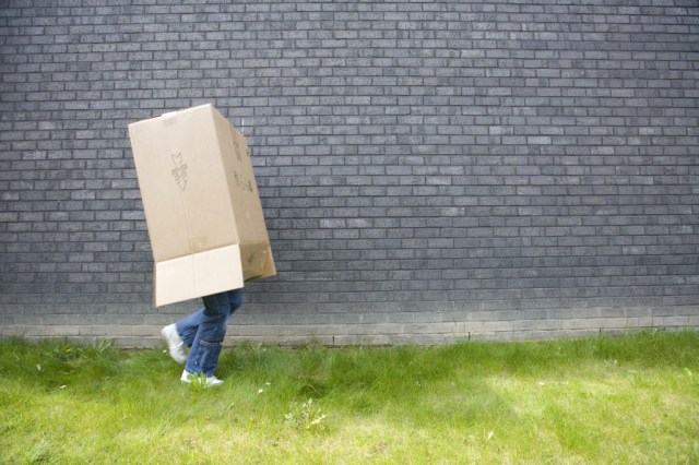 teenager with box on head - Who Am I? Billy Graham Daily Devotional