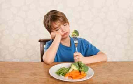 Image may include: kid frowning at salad