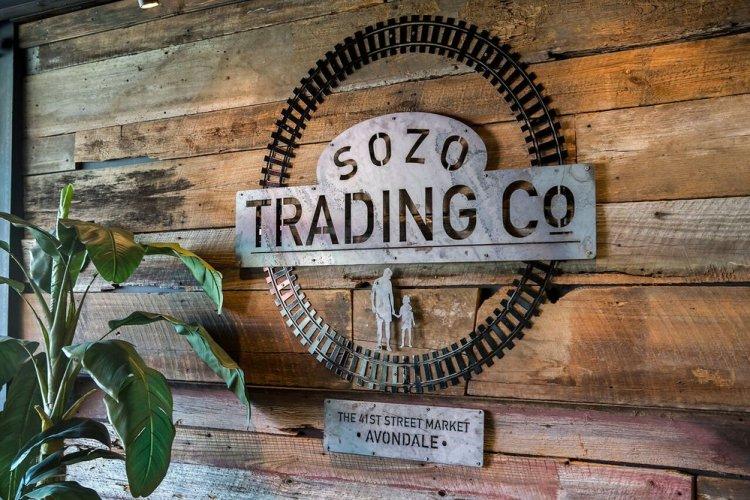 Sozo Trading Company sign on wall