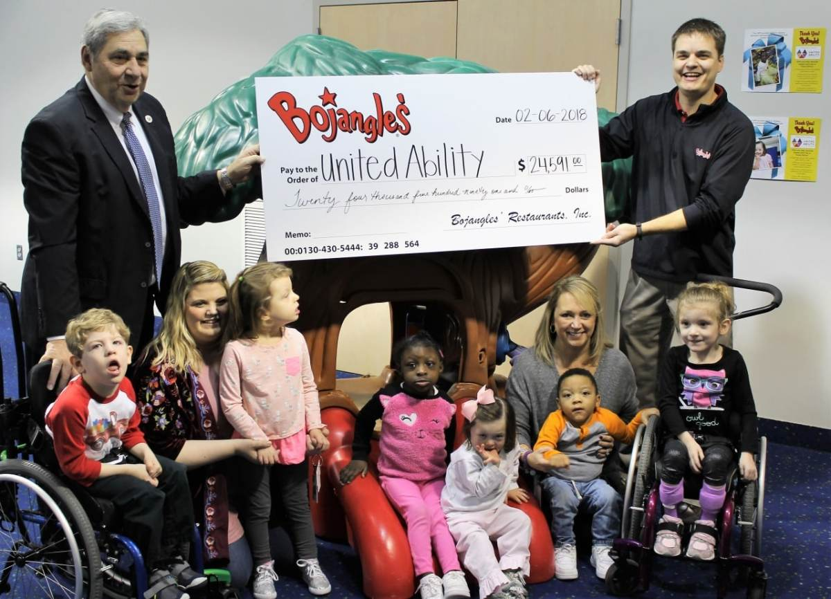 Bojangles' Inc. presents United Ability with check for nearly $25,000