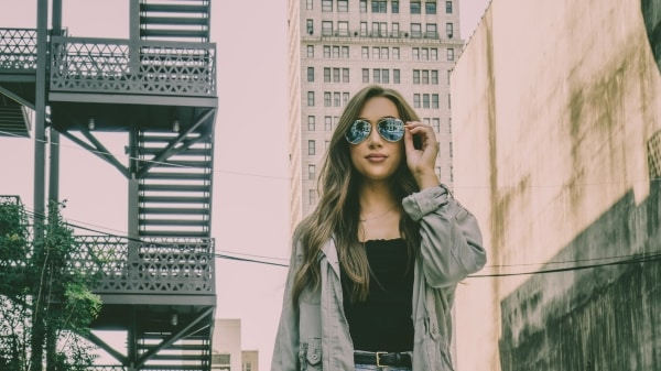 A look at the new Morris Avenue through Aviate's 24K gold Sundance Kittyhawk Sunglasses, a limited-edition collaboration with Maho Shades