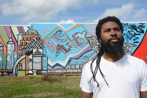 Brian Voice Porter Hawkins in front of a mural at The Bethedsa Life Center