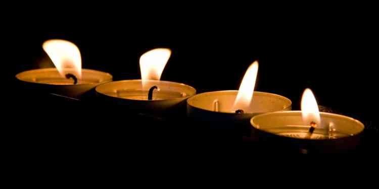 Candles in a piece on holiday depression in Birmingham, and where to turn for support for loneliness, crisis, or suicidal thoughts. Plus, a Blue Christmas service.