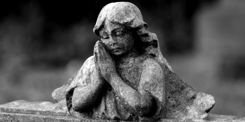 Gravestone angel praying in a piece on holiday depression in Birmingham. And, a Blue Christmas service.
