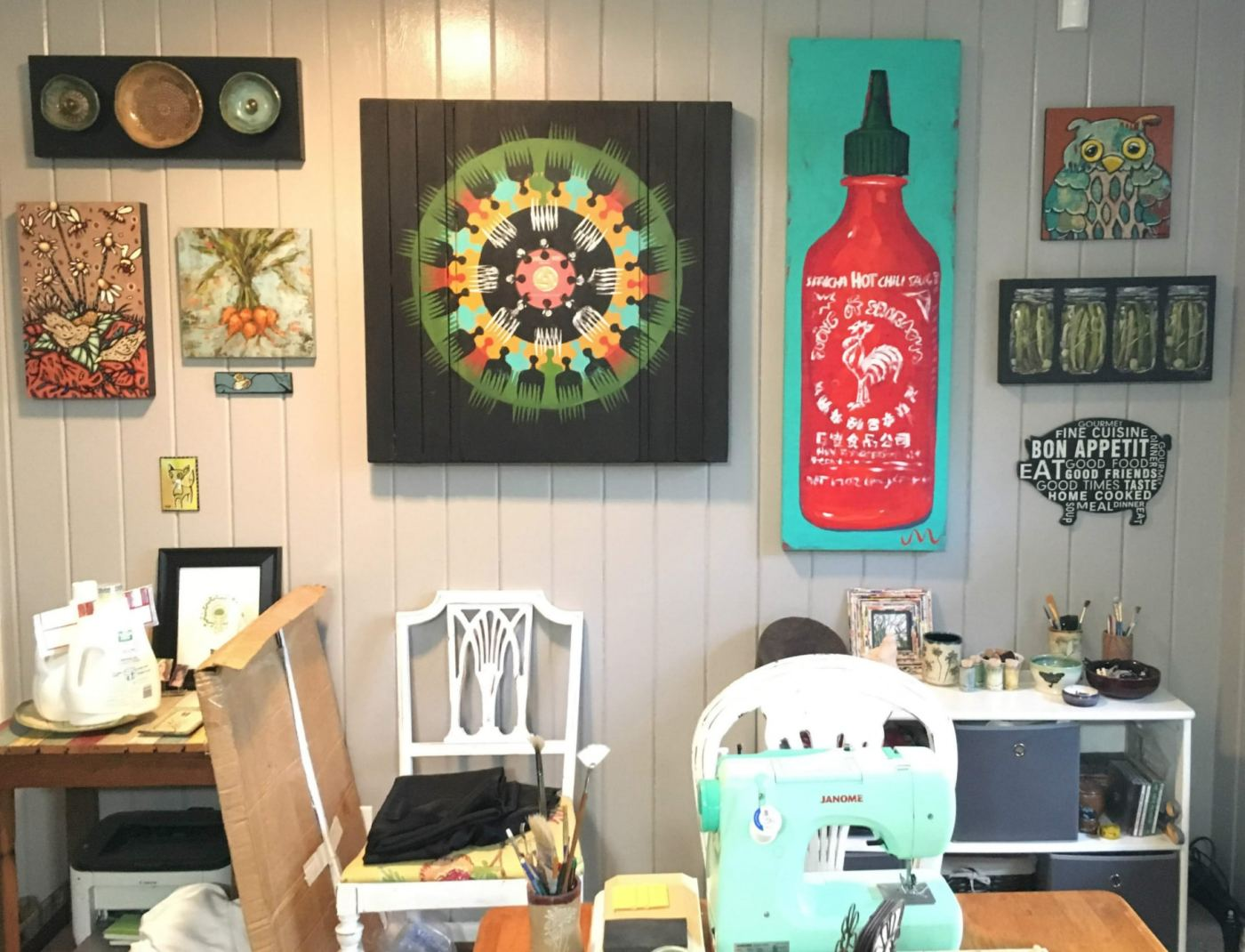 Shelleigh Buckingham, one of the Roebuck Springs potters, has several art walls in her home that feature the work of local Birmingham artists.