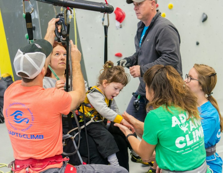 Some of the women climbers in Birmingham help with Catalyst Adaptive Climbing, may have children who participate, or may participate themselves.