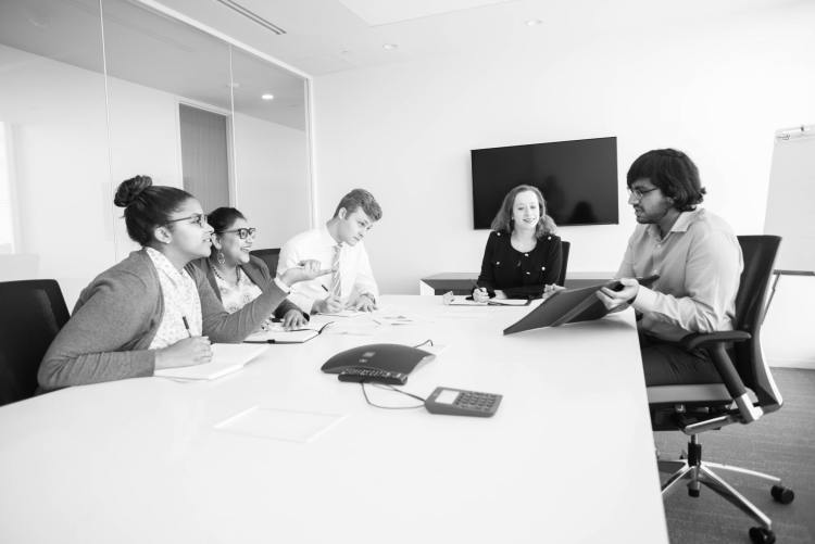Interns at a roundtable discussion