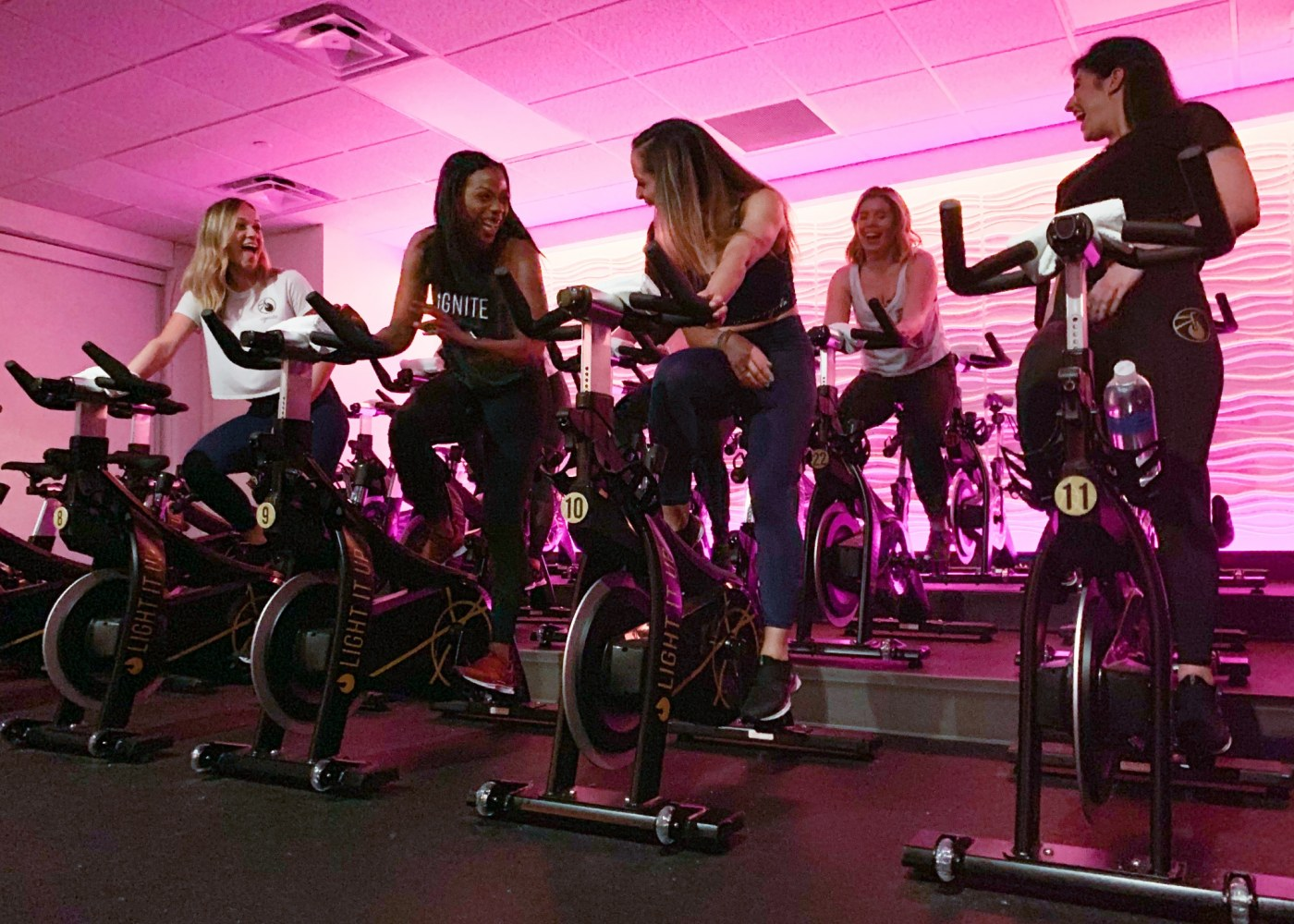 Photo of women on indoor bikes at Ignite Cycle, located in the Pepper Place in Birmingham, Alabama