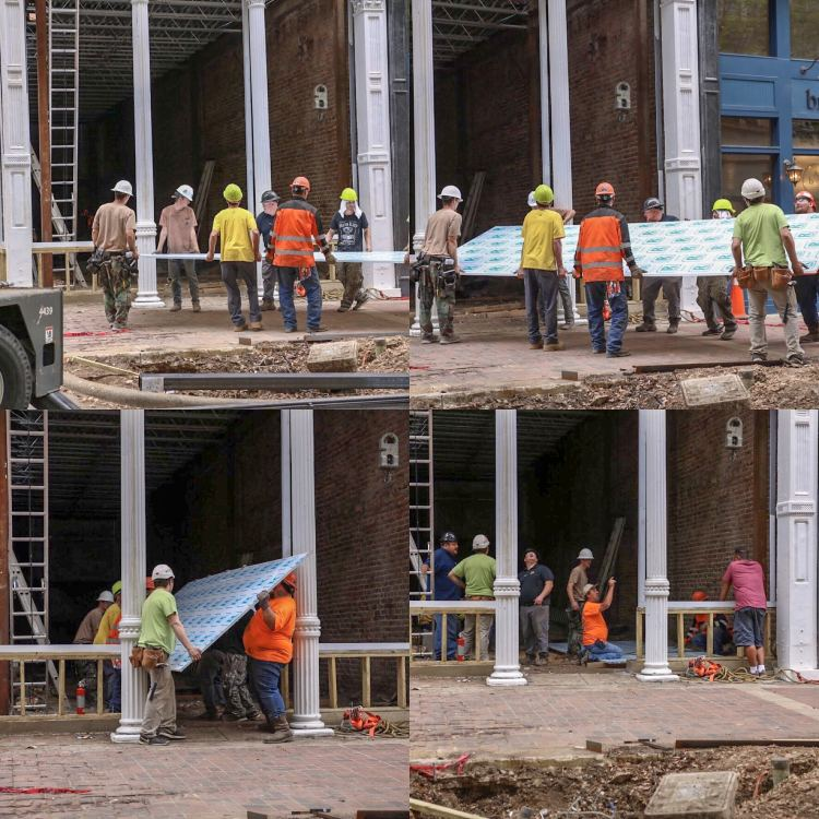 Construction workers carefully install the first enormous window panel at the Iron Building, 20th St North. (Photos by Jacob Blankenship for Bham Now)