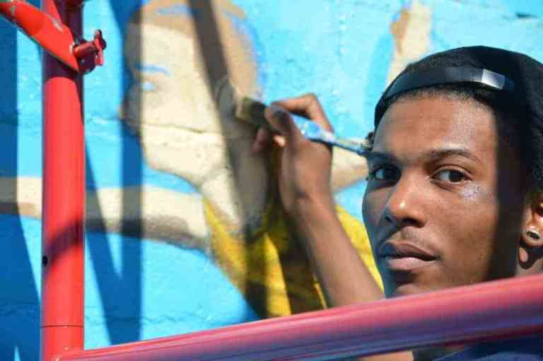 """Thurston Hamby is one of three artists from Blank Space Bham who painted """"The Sky's the Limit,"""" a new-ish mural in Woodlawn."""