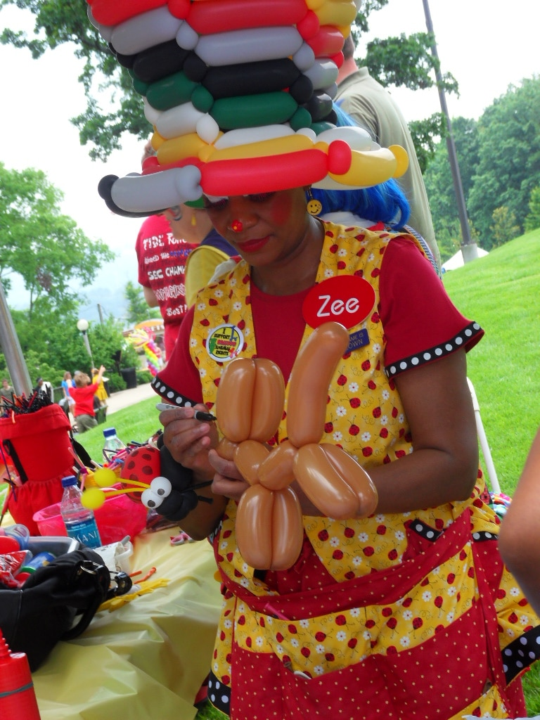 Clown making balloon animals at Vulcan Park's Birthday Bash