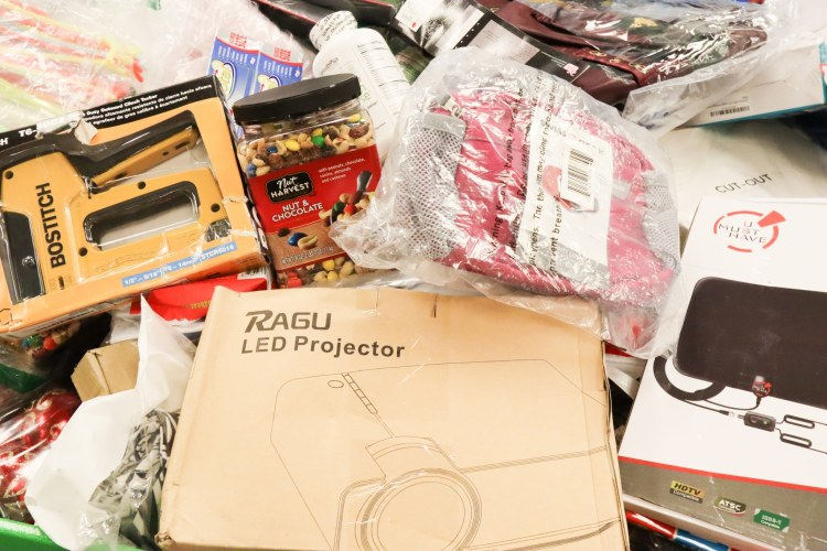 My selection from the third bin I rummaged through. A perfect LED projector, pink fanny pack, industrial stapler and trail mix.  (Photo by Christine Hull for Bham Now)