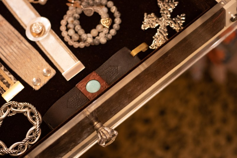 Designer closet by Closets by Design includes velvet drawer liners and crystal doorknobs.