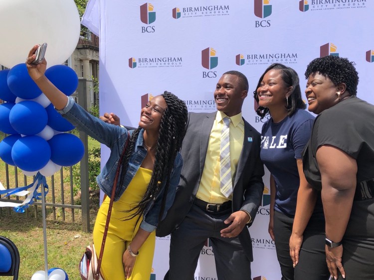 Ramsay High senior Jillian Jolly, center, takes a selfie with Birmingham City Schools Superintendent Dr. Lisa Herring, far right; senior Kennedy Whisenant, a far left, and junior Micaiah Collins on May 1 after announcing she plans to attend Yale University. (Photo by Chanda Temple, City of Birmingham )