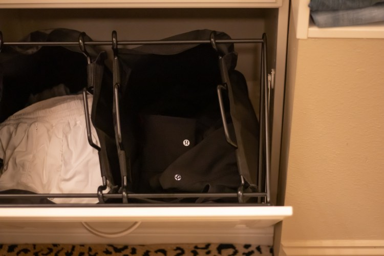 There's a hamper for darks and lights in this designer closet by Closets by Design.