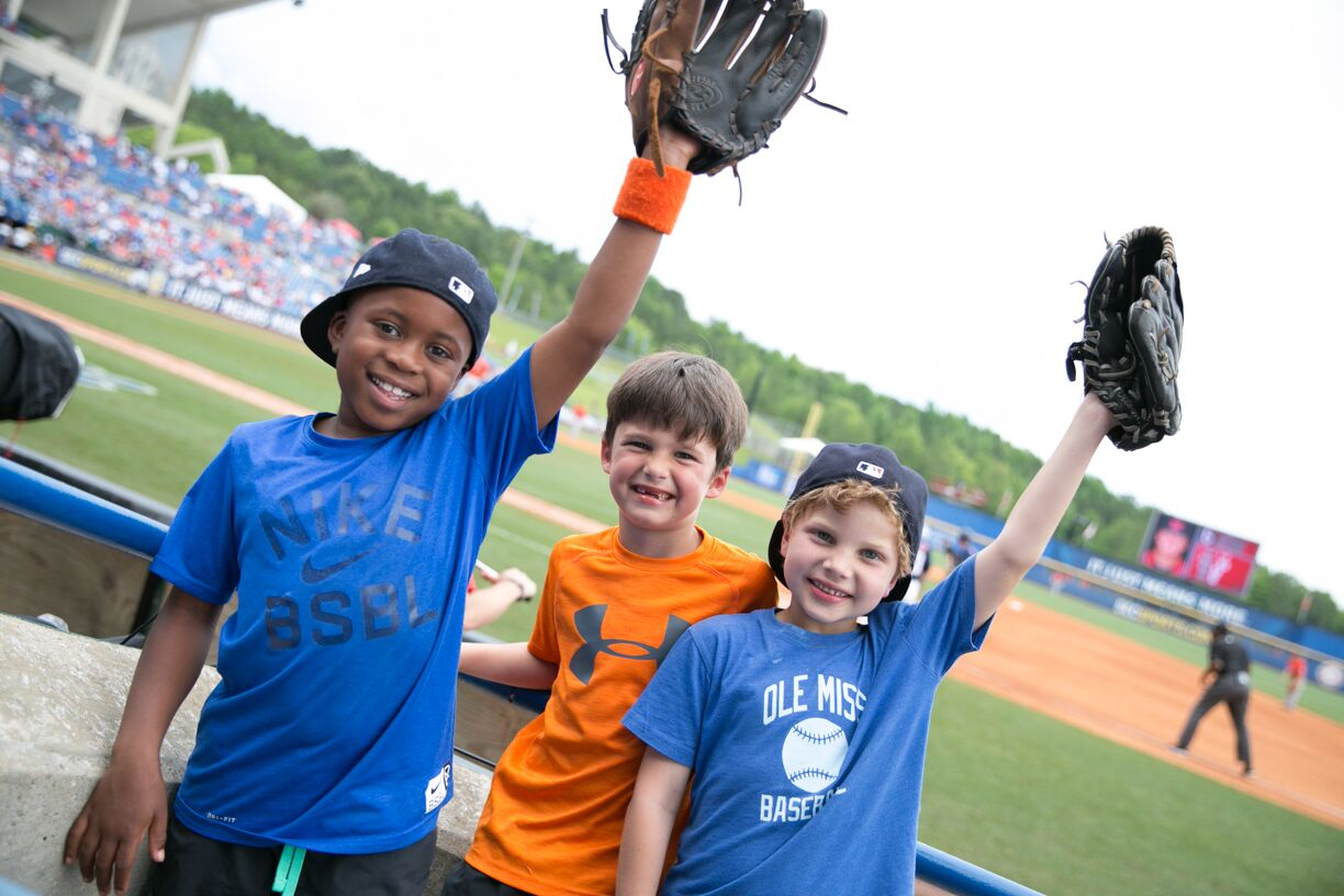 The tournament is a perfect place to bring your baseball loving kiddos! Be sure to pack their gloves for some foul ball catching. Photo via SEC Baseball Tournament