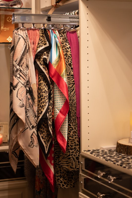 Scarf pulls are another nice feature in designer closets by Closets by Design.