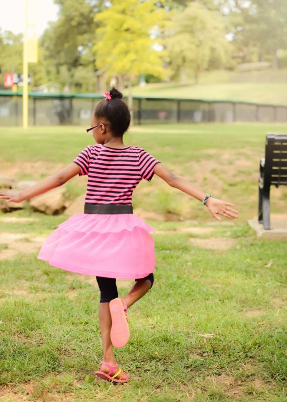 Picture of a girl in foster care twirling. By Heart Gallery of Alabama.