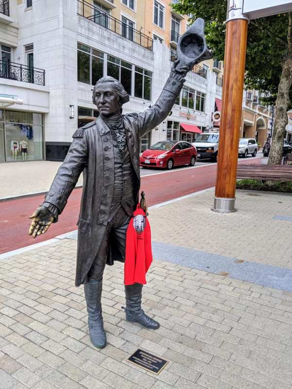 Disco Amigos t-shirt on a statue of Sam Adams striking a pose.