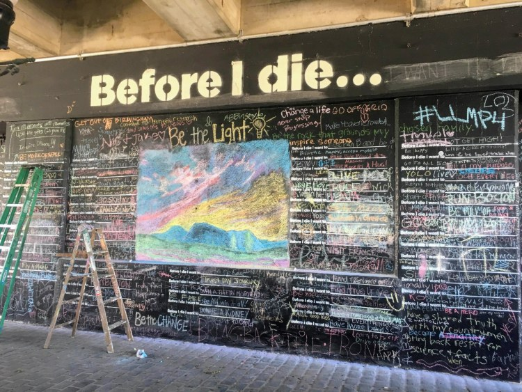 """You can write on the """"Before I die"""" mural on Morris Avenue."""