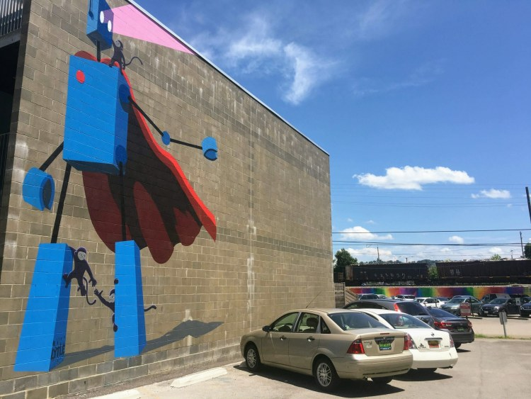 From this spot, you can see two murals: the robot mural and the Rainbow Wall.