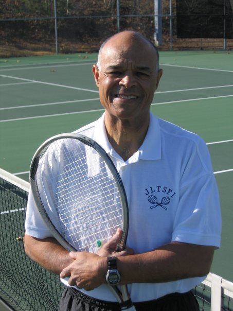 Coach Rudy Lewis manages the George Ward Tennis Center and coached the winning team.
