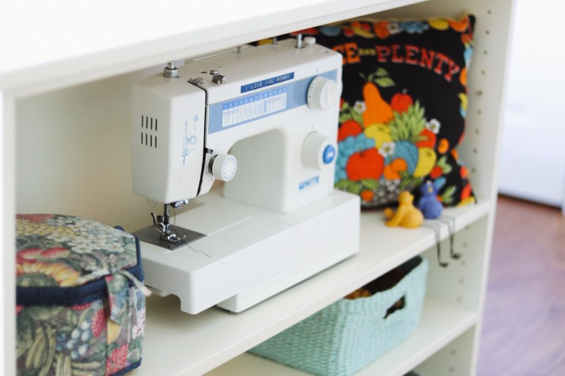 Sheila has spots for all the things in her Closets by Design sewing room.